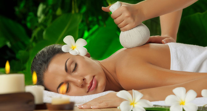 tattooed masseur touching oiled body